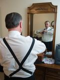 Getting Dressed. A senior man prepares for his wedding stock image