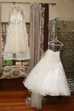 Getting dressed. Wedding gown and pettycoat waiting to be adorned royalty free stock photo