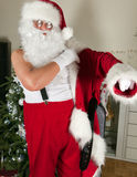 Getting dressed for christmas. Adult man getting dressed in his santa costume for christmas Stock Photography