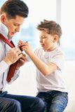 Getting dressed with father Royalty Free Stock Photos