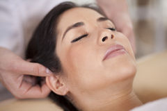 Getting an ear massage and relaxing Royalty Free Stock Photography