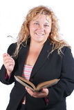 Getting educated. Smart woman reading a book . Business woman or teacher royalty free stock images