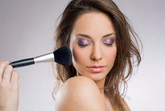 Getting an elegant makeup. Royalty Free Stock Image