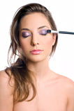 Getting an elegant makeup. Royalty Free Stock Photography