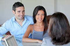 Getting financial advice. Couple meeting financial adviser for investment Royalty Free Stock Images
