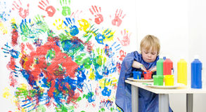 Getting finger paint Stock Images
