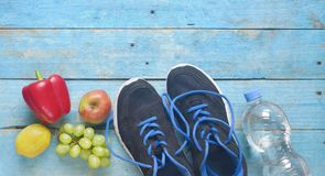 Getting fit and reducing weight for the springtime, pair of runners and fruit,free copy space,flat lay royalty free stock images
