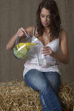 Getting a glass of lemonade Stock Photo