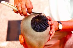 Getting a hair-cut for thread ceremony, Upanayana, a Hindu ritual. Performed only for man in his childhood royalty free stock photo