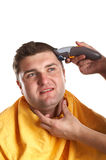 Getting a Haircut. Handsome man getting a haircut - isolated white background Stock Photo