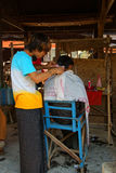 Getting a haircut at the weekly market Royalty Free Stock Photo