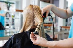 Getting a Hairstyle royalty free stock photo
