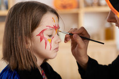 Getting Halloween make-up Royalty Free Stock Photography
