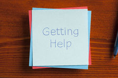 Getting Help written on a note Royalty Free Stock Photography