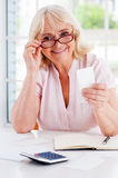 Getting her finances straight. Stock Photography