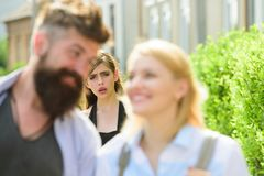 Getting her jealous. Romantic couple of man and woman dating. Bearded man cheating his girlfriend with another woman. Getting her jealous. Romantic couple of men stock image