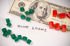 Getting a Home Loan. With Cash And Mini Houses stock photo