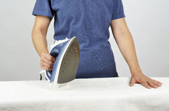 Getting the ironing done Royalty Free Stock Photo