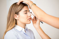 Getting make-up done at a salon Royalty Free Stock Images