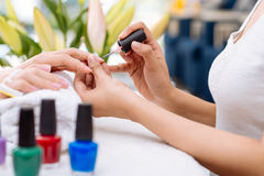 Getting manicure Stock Images