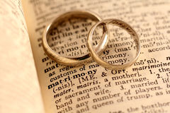 Getting Married - Matrimony Text with Wedding Band. The word matrimony in the dictionary with two wedding bands atop Stock Photos