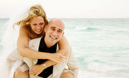Getting married. Beautiful couple just get married on the beach and having some fun Royalty Free Stock Photography