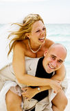 Getting married. Beautiful couple just get married on the beach and having some fun Stock Photos