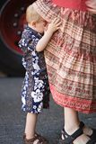 Getting moms attention. Young child trying to get his mother's attention by lifting mom's skirt royalty free stock images