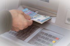 Getting Money At ATM Royalty Free Stock Photos