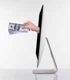 Getting money from Computer monitor creativity Royalty Free Stock Image