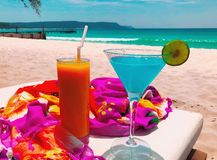 Exotic Colorful Drinks on a Sandy Beach royalty free stock image