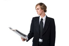 Getting news. Male Absorbed in reading of a newspaper Royalty Free Stock Photos