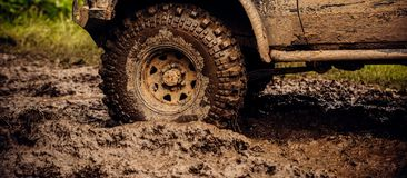 Getting Off The Beaten Path. Car Wheels On Steppe Terrain Splashing With Dirt. SUV Or Offroader On Mud Road. Car Racing Royalty Free Stock Photo