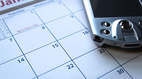 Getting organized. Calender with a personal digital assistant pda device stock images