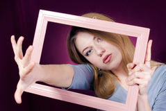 Getting out of frame Beautiful blond young woman Royalty Free Stock Photos