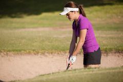 Getting out of a sand trap Stock Photography