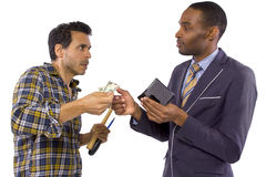 Getting Paid. Businessman paying hired blue collar laborer for services stock photo