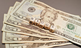 Getting Paid to Blog. American Money With Word Blogs For Getting Paid To Blog Concept Royalty Free Stock Photo