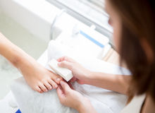 Getting a pedicure Royalty Free Stock Photo