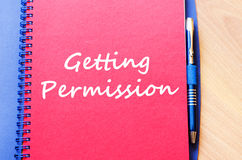 Getting permission write on notebook. Getting permission text concept write on notebook with pen Royalty Free Stock Photo