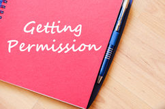 Getting permission write on notebook. Getting permission text concept write on notebook with pen Stock Image