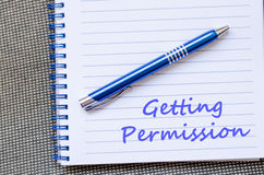 Getting permission write on notebook. Getting permission text concept write on notebook with pen Stock Photos
