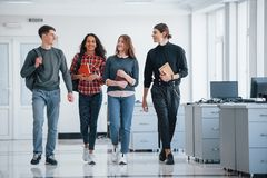 Free Getting Prepared For Today`s Work. Group Of Young People Walking In The Office At Their Break Time Royalty Free Stock Photo - 167171735