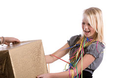 Getting a present. Young teenage girl getting a big box for a present Stock Photos