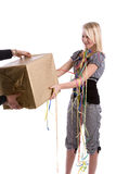 Getting a present. Pretty blond teenage girl with braces receiving a present Stock Image