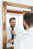 Getting ready for the big occasion. Handsome man getting ready for the big occasion Royalty Free Stock Image
