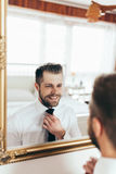 Getting ready for the big occasion. Handsome man getting ready for the big occasion Stock Images