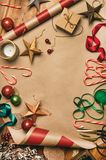 Christmas decorations and balls over wrapping paper, copy space royalty free stock photography