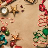 Christmas decorations and balls over wrapping paper, square crop royalty free stock photo