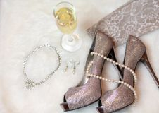 Getting ready for holiday party. Getting ready for a holiday party - women`s accessories royalty free stock image